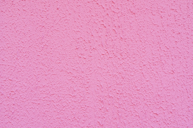 Texture of rough pink plaster. architectural abstract background.