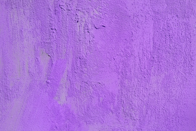 Texture of rough violet plaster. architectural abstract background.