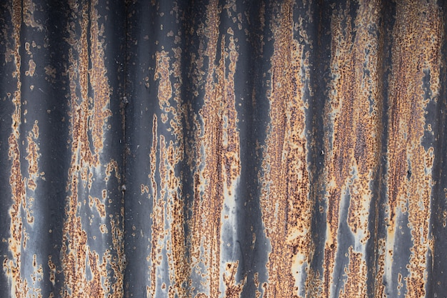 The texture of rusty wavy metal with black paint