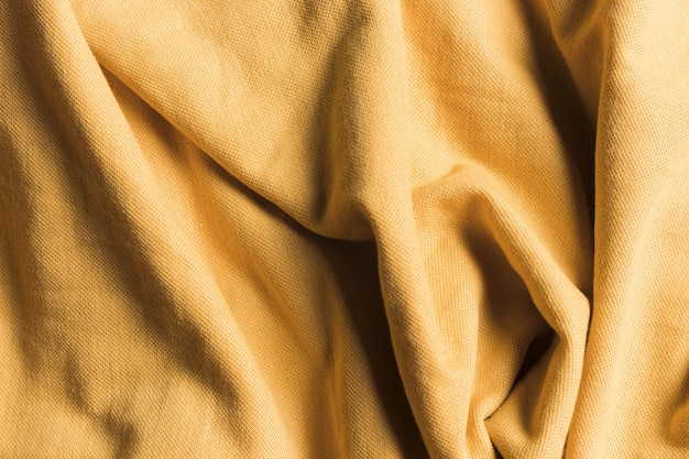 Texture of sand brown crumpled fabric