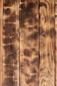 The texture of the scorched wooden wall.