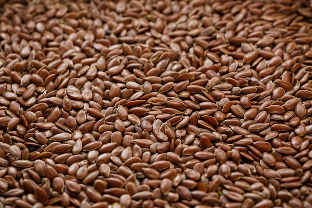Texture of seeds of dark brown flax.