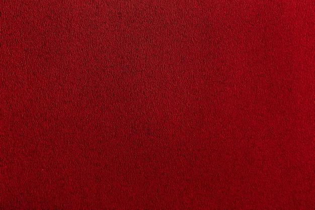 緋色の紙のテクスチャシート。 bordoダークスムースサーフェス。抽象的な赤い背景。