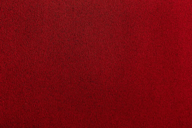Texture sheet of scarlet paper. bordo dark smooth surface. abstract red background. Premium Photo