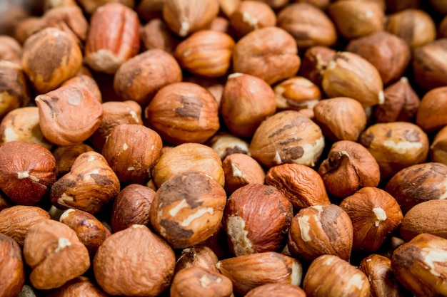 The texture of the shelled hazelnuts. selective focus.