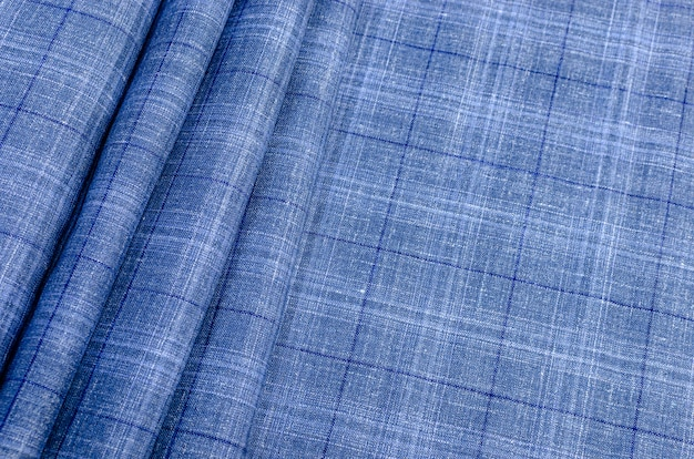 The texture of the silk fabric in a blue and blue check. background, pattern