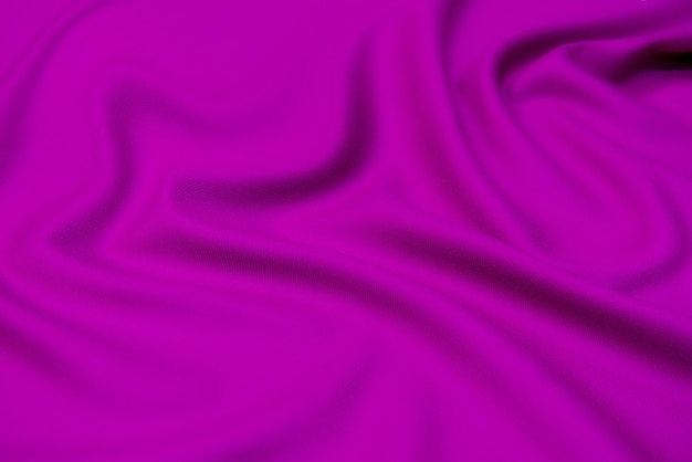 The texture of silk fabric in fuchsia. background, pattern.