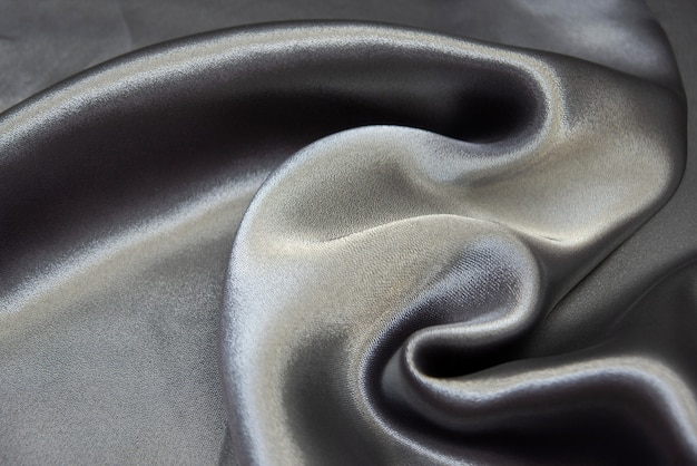 The texture of the silk fabric is silver-blue. chiffon. background, pattern.