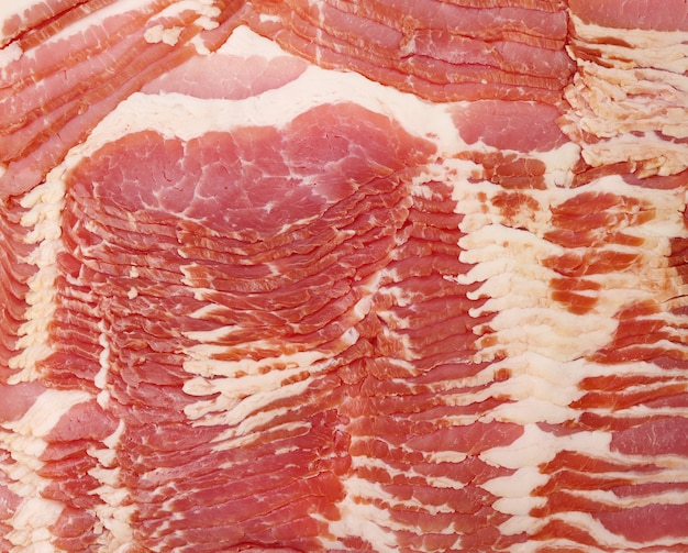 Texture of sliced raw bacon, full frame, close up