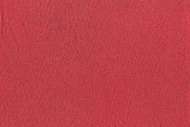 Texture of slightly wrinkled red fabric