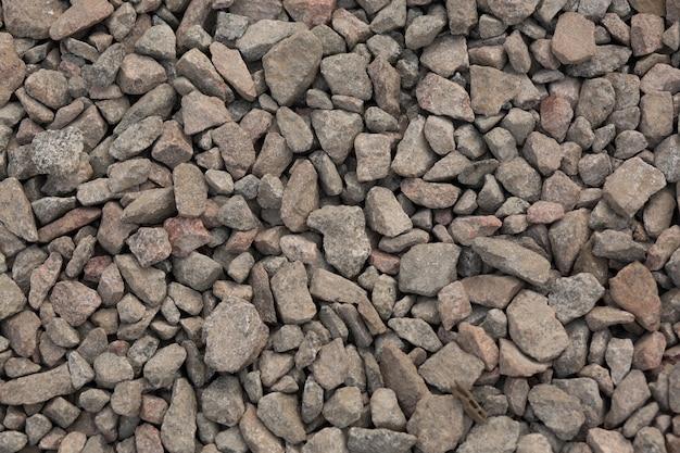 Texture of small crushed granite stone. closeup shot