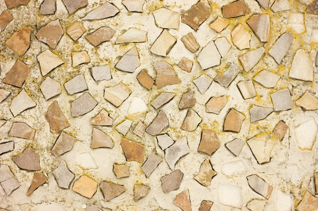 Texture of small stones on concrete, stone savage laid out on concrete in a chaotic manner