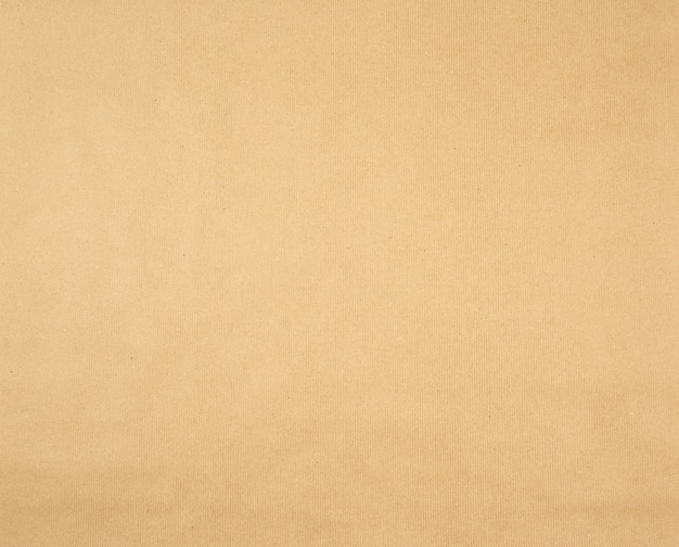Texture of smooth brown kraft wrapping paper background