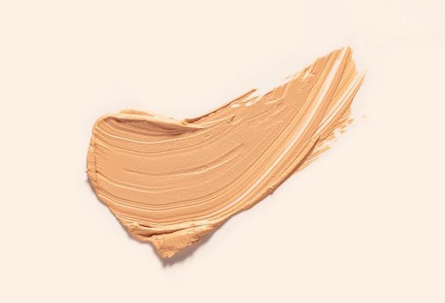 Texture of smudge cosmetic bb or cc cream foundation liquid background Premium Photo
