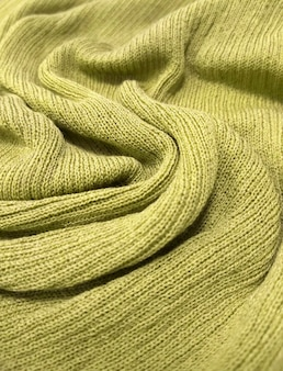 The texture of the soft knitted fabric is like a yellow background.