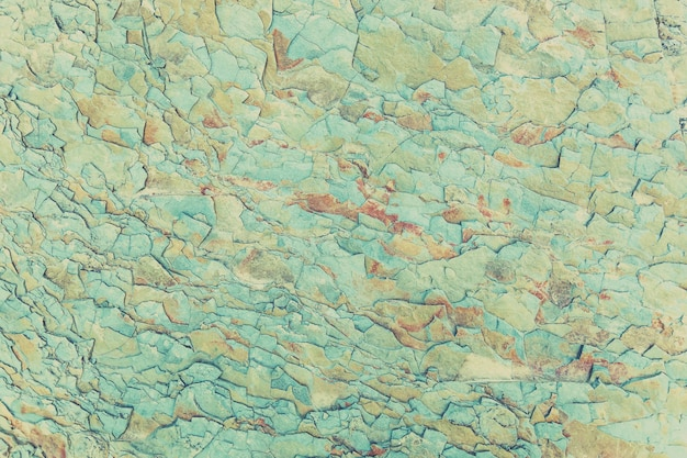 The texture of the stone is blue with red spots