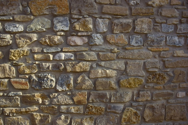 The texture of the stone, laid out on the wall, of different shapes and shades for the entire frame