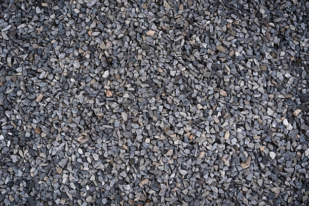 Texture of stones on the ground gray pebbles. stone background