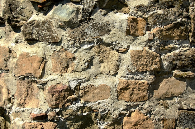 The texture of stones together with cement.