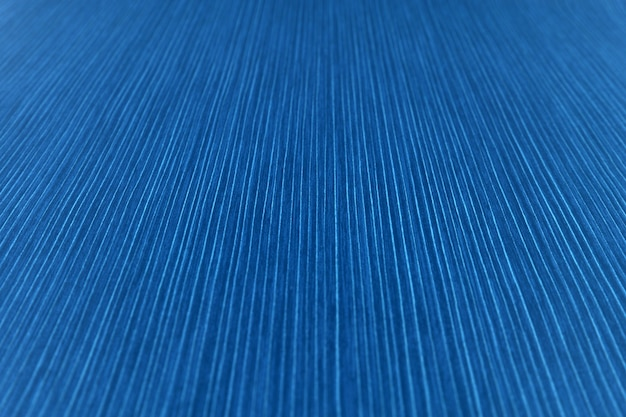 The texture of the striped paper in a bright blue shade