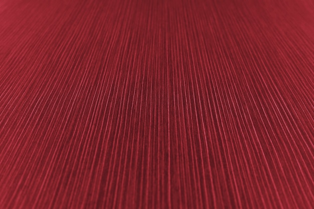 The texture of the striped paper in a red shade