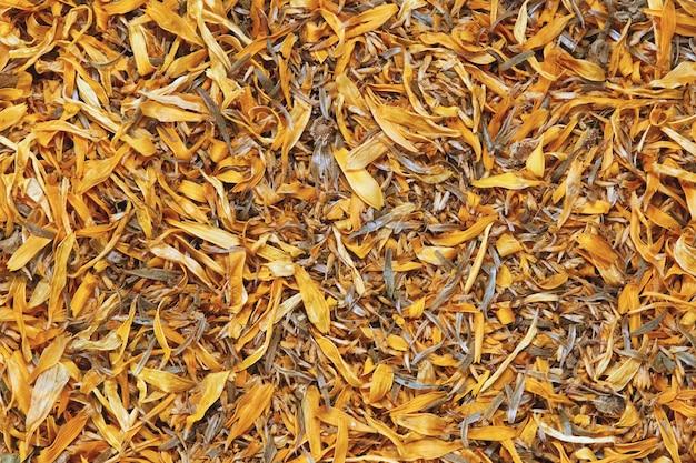 Текстура поверхности сухих цветов календулы лекарственной или календулы