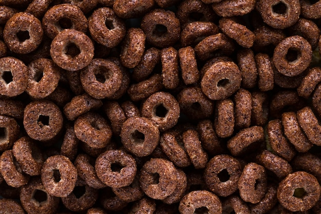 Texture and surfce of dry, chocolate rings for cereals breakfast.