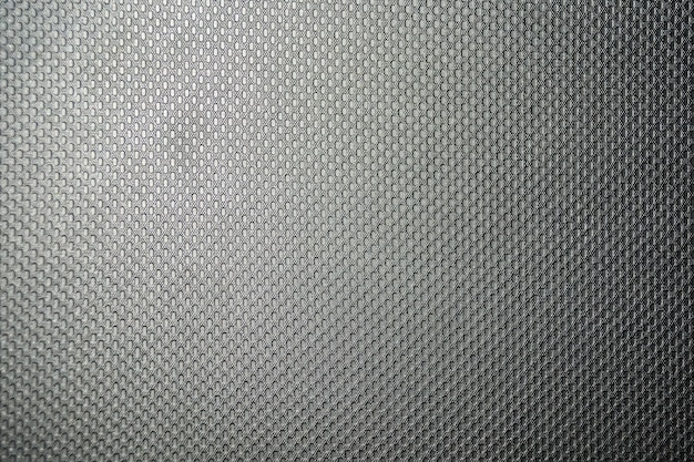 Texture of a synthetic, evenly lit gray cloth