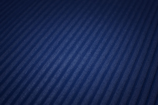 The texture of the synthetic fabric is dark blue. plisse.