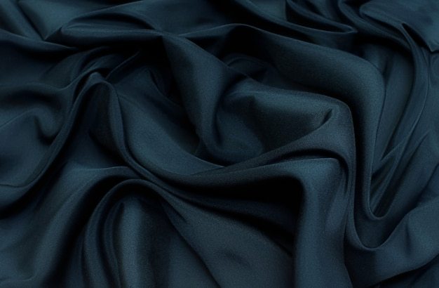The texture of the synthetic fabric is dark green. background, pattern.