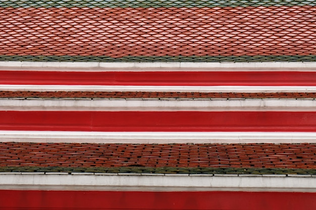 Texture of tile red roof in thai temple