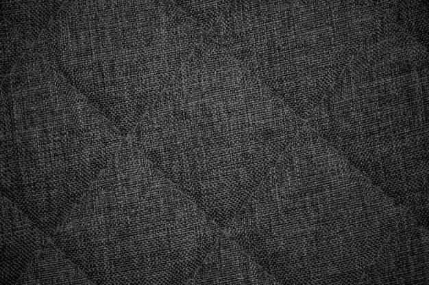 テクスチャtissu、ダークグレーのニット生地の背景