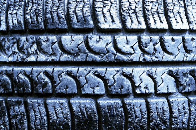 Texture of the tread wheel. old tire close up.