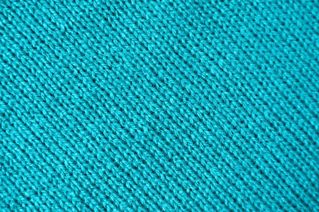 Texture of turquoise blue colored alpaca knitted wool fabric