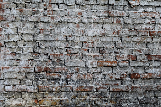 Texture of a vintage rustic old red brick wall