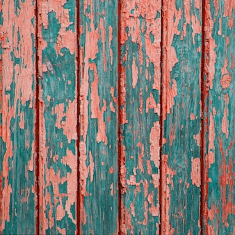 Texture of vintage turquoise painted wooden background with layers of paint