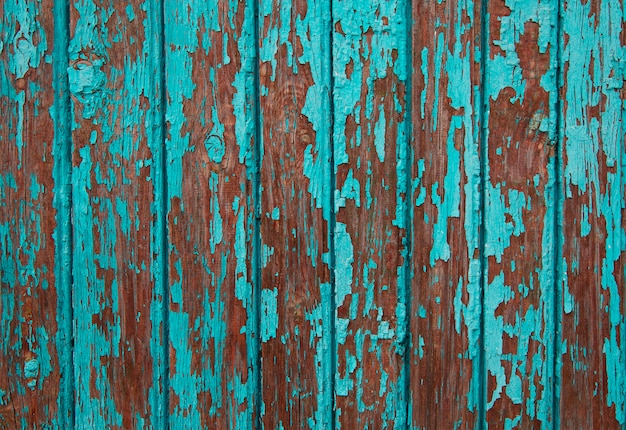 Texture of vintage turquoise painted wooden with layers of paint