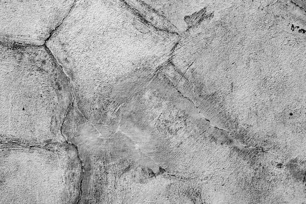 テクスチャ、壁、コンクリート。傷やひび割れのある壁の破片