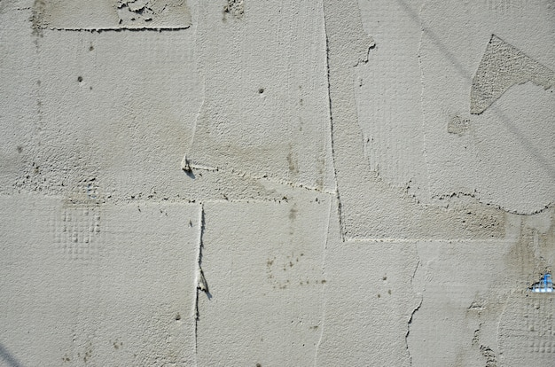 The texture of the wall, covered with gray foam polystyrene plates, which are smeared with a reinforcing mixture.