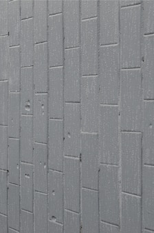 The texture of the wall from the old tile, painted gray under the influence of condensation. a lot of small drops and water stains on the wall