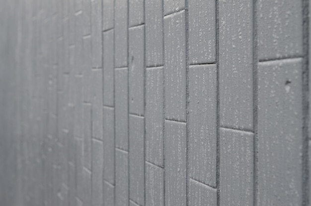 The texture of the wall from the old tile, painted gray