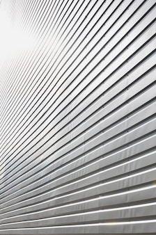 The texture of the wall is made of metal coating of huge aluminum plates of relief shape