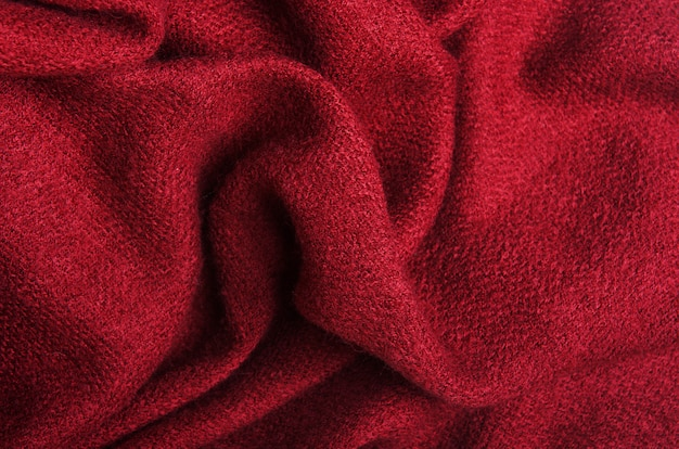 The texture of warm knitted burgundy linen