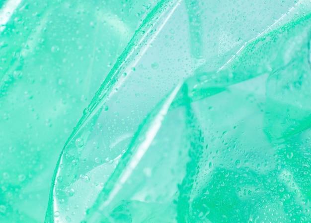 Текстура капли воды на пластике, абстрактный фон пластиковые капли, пластиковая поверхность, капли воды на пластике. пластиковая поверхность морщинистая и рваная, образуя абстрактный узор.