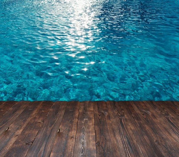 Texture of the water in the pool and place for text on a wood