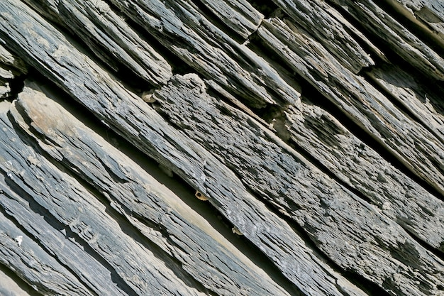 Texture of weathered stone wall in the sunlight for background or banner