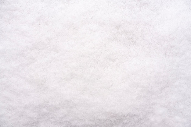 Texture of white fresh snow. winter background