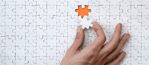 The texture of a white jigsaw puzzle in the assembled state