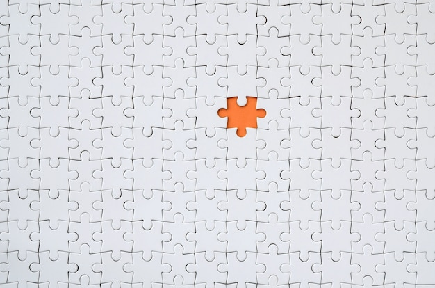 The texture of a white jigsaw puzzle in an assembled state