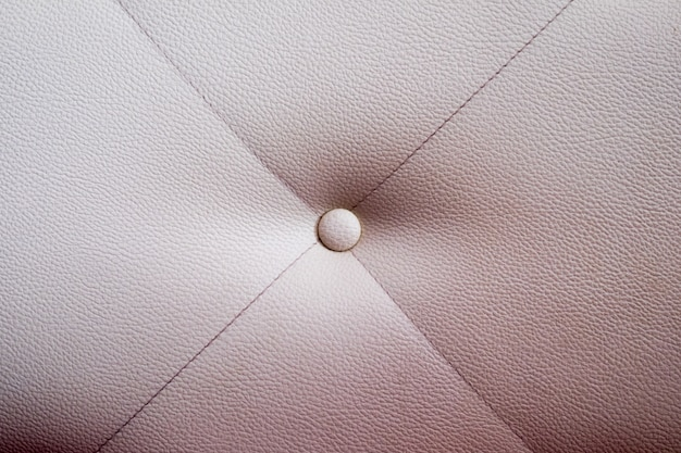 Texture of white leather furniture with button